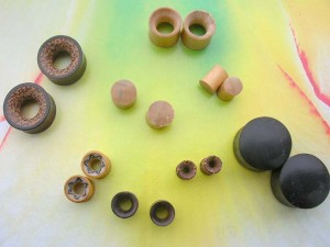 Wooden Saddles Plugs Tunnel Earlets small to large gauge mix. Wooden plugs and ear stretchers and expanders