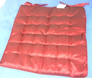 polyester padded sitting cusion red color 15 inches by 15 inches