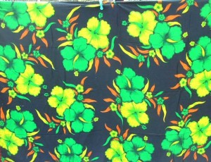 black sarong with green yellow hibiscus flowers