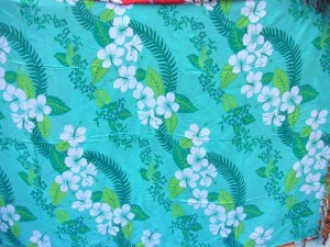 bluish green wavy rows Hibiscus flower sarongs Hawaiian print Bali Indonesia pareo