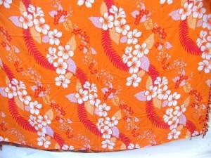 orange wavy rows Hibiscus flower sarongs Hawaiian print Bali Indonesia pareo