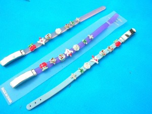 bubber bracelet with enamel charms