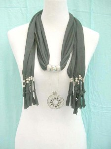 Scarf with charm necklace, vintage cutout pendant with link chain made of polyester but feels like soft cotton 70 inches long (include tassels), 18 to 20 inches wide mixed colors randomly picked by our warehouse staffs