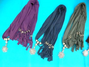pendant scarf necklace jewellery with cutout filigree flower and seahorse desings made of polyester but feels like soft cotton 70 inches long (include tassels), 18 to 20 inches wide mixed colors randomly picked by our warehouse staffs