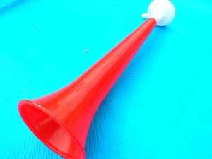 plastic short horn 11 inches long, large end 3 inches in diameter