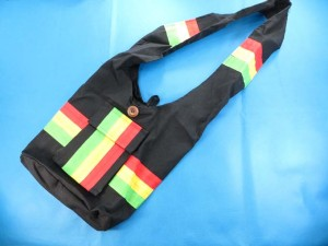 rasta long wide strap shoulder bags in black, green, yellow, red colors cotton thick fabric, linened, front pocket with coconut button bag size: 14 inches by 14 inches full length (from top of shoulder to bottom of bag): 35 inches