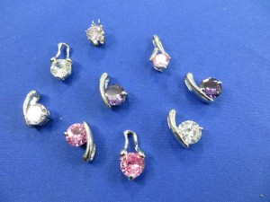 mini cz charms around 0.5 inches in length, cz stone size around 0.25 inches in diameter