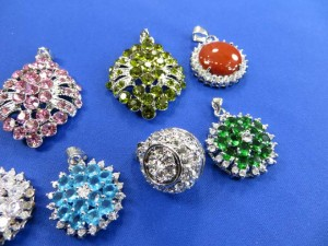 fancy multiple cz embeded pendants charms around 0.75 to 1 inches in length / diameter