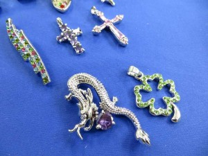 cz embebed pendant charms in assorted designs  around 0.75 to 1.25 inches in length / diameter