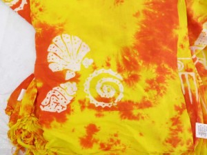 monocolor yellow orange sarong screen printings with leaves, sun, dolphin, seashell, palm leaves etc tropical designs