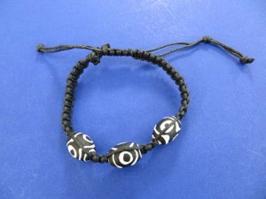 black hemp macrame bracelet with black and white beads