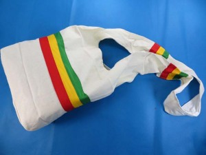 rasta long wide strap shoulder bags in white, green, yellow, red colors cotton thick fabric, linened, front pocket with coconut button bag size: 14 inches by 14 inches full length (from top of shoulder to bottom of bag): 35 inches