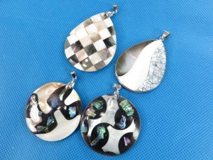 natural seashell moasic pendants in assorted designs and shapes  size around 2 to 2.5 inches in length