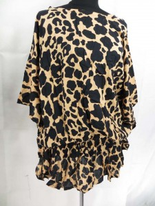 Dropped sleeve elastic waist kaftan caftan top in animal skin print. Made in Bali Indonesia.. Approximate 32 to 34 inches in length. Bust and waist 60 to 62 inches. Fits over size women. One size fits for all (S, M, L, X., 1X, 2X, 3X, 4X, 5X, 6X )