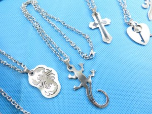 assortment designs of stailess steel pendant necklaces chain size around 18 inches pendant size around 1.75 to 2.75 inches in length