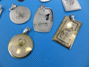stainless steel pendants in assorted designs pendant size around 1.75 to 2.75 inches in length