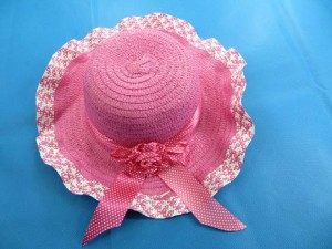 lady's summer straw hat with ruffle brim and ribbon flower