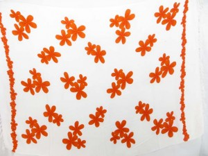 white sarong with orange hibiscus flowers
