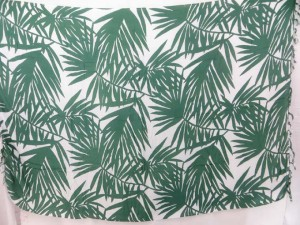 green palm leaf on white background sarong