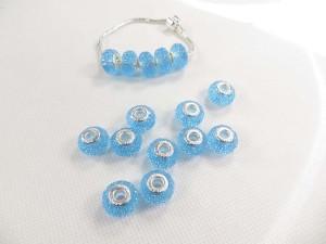 Candy style light blue acrylic rhinestone bead.