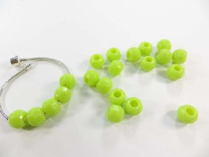 Green acrylic faceted bead