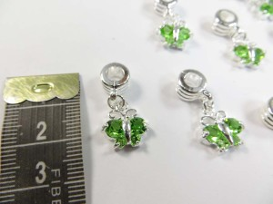 Alloy metal dangle charm bead with green cz crystal butterfly