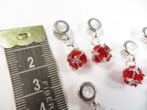Alloy metal dangle charm bead with red cz crystal