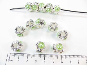 Alloy metal bead with green faux pearl