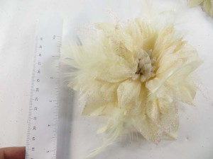 Cream color flower corsage with glitter edging and feather