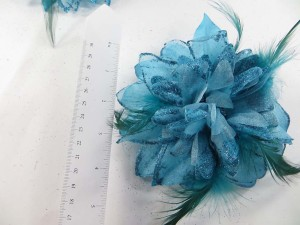 Greenish blue color flower corsage with glitter edging and feather