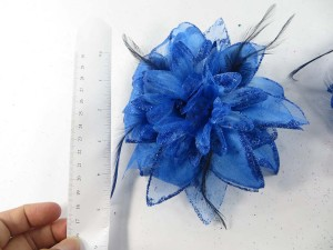 Blue color flower corsage with glitter edging and feather