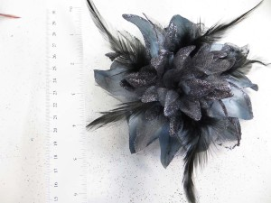 Bluish grey color flower corsage with glitter edging and feather
