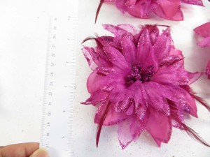Fuschia hot pink color flower corsage with glitter edging and feather