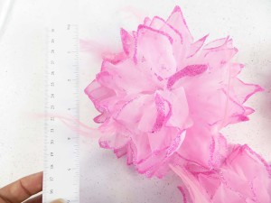 Light pink color flower corsage with glitter edging and feather
