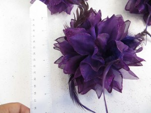 Dark purple color flower corsage with glitter edging and feather