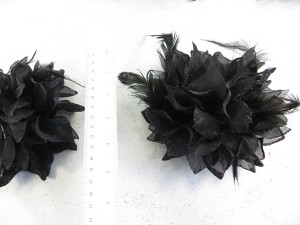 Black color flower corsage with glitter edging and feather