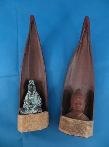 Metal Buddha small statue under tree leaf