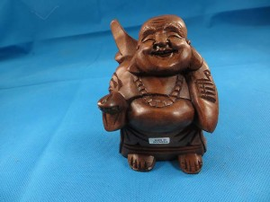 Laughing Buddha wooden statue