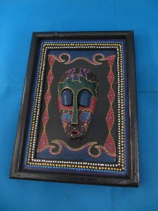 wood carving mask embed on frame.