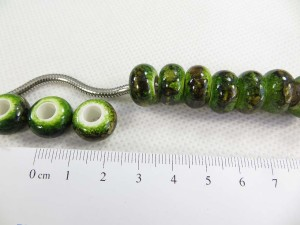 Acrylic resin bead in green color with black paints