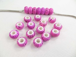 Acrylic resin bead in pink color with black zebra prints