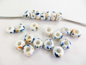 Acrylic resin bead in white color with blue and yellow paints