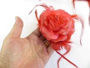 Light red color rose flower corsage with glitter edging and feather