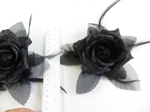 Black color rose flower corsage with glitter edging and feather