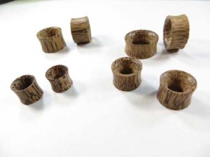 Coconut wood saddles plugs tunnel earlets small to large gauge mix. Wooden hollow plugs and ear stretchers and expanders