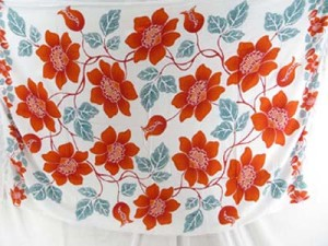 Caribbean tropical dresses sarongs with orange red flower on white background