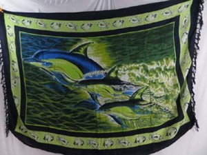 green sarong with dolphins and black borders