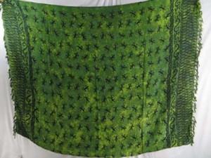 green sarong with small lizard geckos