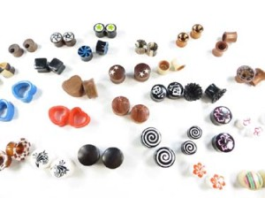 Medium gauge wooden and acrylic ear plugs, ear tunnels earlets. Handmade gauges ear plugs, ear stretchers and expanders. Many designs, almost each pair is unique, assorted designs sizes gauges randomly picked by our staffs