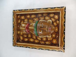 brown color hand-crafted hand-painted wooden mask on frame
